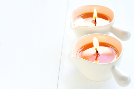 Hot massage candle for treatment skin.