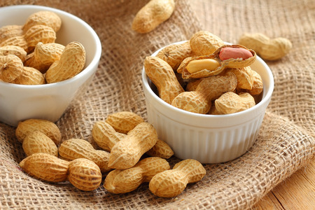 Peanut is raw food for snack brown background.