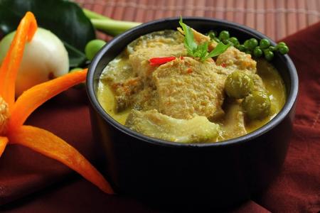 Chicken green curry  Thai food brown background.