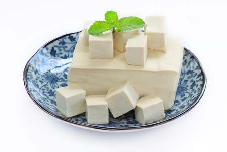 Tofu fresh is raw food with vegetarian food, isolate background. Stock Photo - 83857139