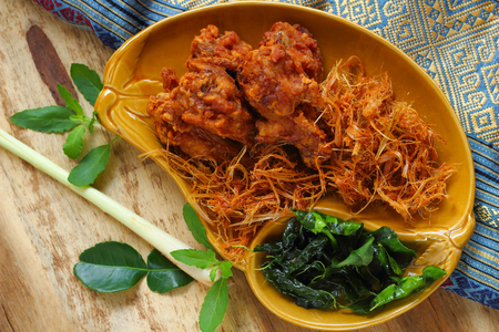 Fried chicken and  herbal  Thai style food.
