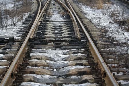 branching: Railway and railroad ties. Branching rails and dirty snow. Stock Photo
