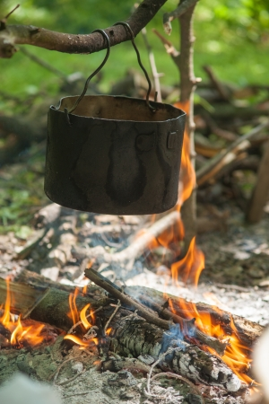 Pot for cooking on a fire in a campaign photo