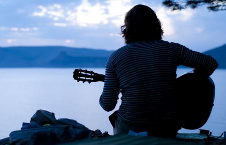 over the sea: guitarist Stock Photo