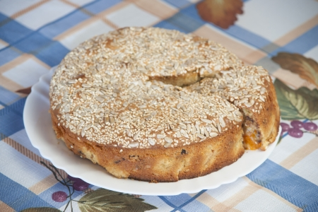 Apricot pie on plate. High resolution photo