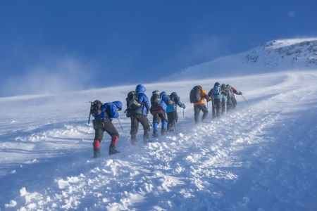 ice climbing: A group of alpinists on their way to the Elbrus Stock Photo