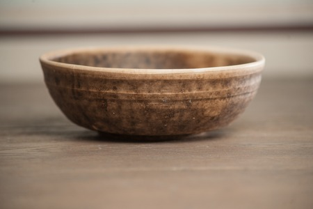 handcrafted: Traditional handcrafted dish of brown color on the table