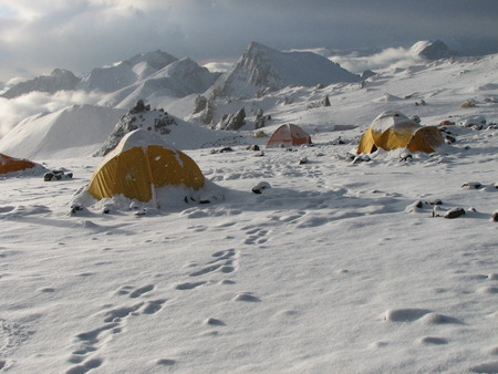 Tents under snow in the camp, Andes, Argentina, South America photo