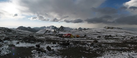 Tents under snow in the camp, Andes. photo