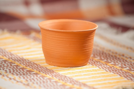 handcrafted: Traditional handcrafted mug on the multycolor background