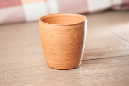handcrafted: Traditional handcrafted mug on multycolor background. High resolution