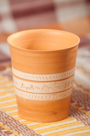 Traditional handcrafted mug on multycolor background. High resolution