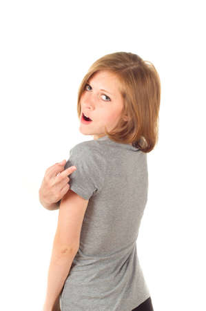 obscene: girl showing middle finger on white background Stock Photo