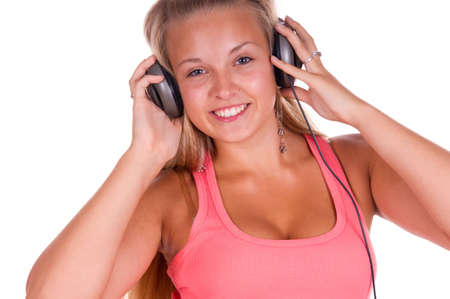 young woman listen music isolated on a white background photo