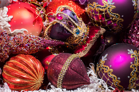 shiny background: Christmas tree decorations, all in one color, crimson background