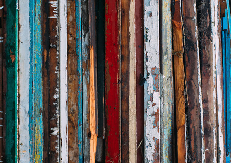 vertical lines: Colorful vertical lines, pile of wooden doors, cracked old paint on wood