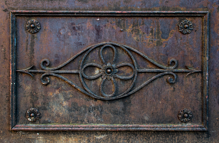 Rusted forging ornament on door