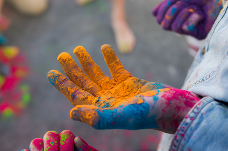 three hands: Three hands with multicolor dry hawley paint