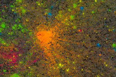 Multicolored dry paint on the asphalt