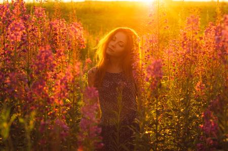 foxy girls: Beautiful girl on field, sun backlight, sunrise, orange colors, closed eyes
