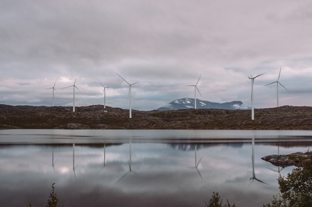 Electricuty wind turbines on mountains of Norway