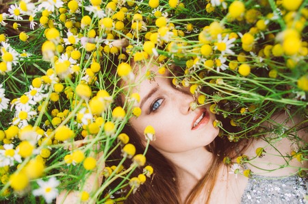 Portrait of young girl in chamomile field Stock Photo