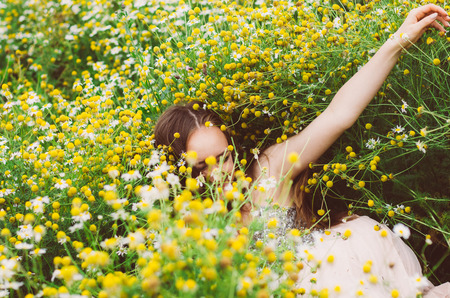 Portrait of smiling young girl in chamomile field