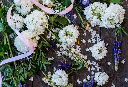 Composition with different flowers - lupine, viburnum, peonies, fleur-de-lis, iris Stock fotó