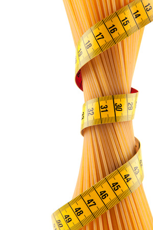 Bunch of spaghetti strapped meter on a white background symbolizes the importance of proper nutrition photo
