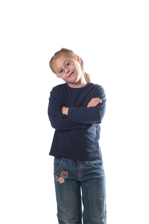 Standing with his hands crossed on his chest girl wearing jeans on a white background