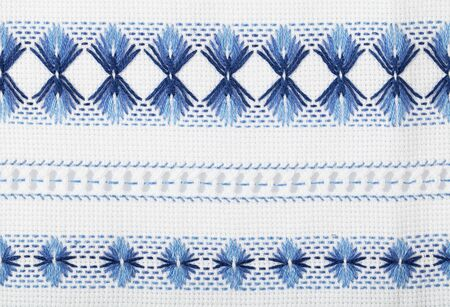 Traditional Ukrainian national pattern. Two-color embroidery on white fabric.