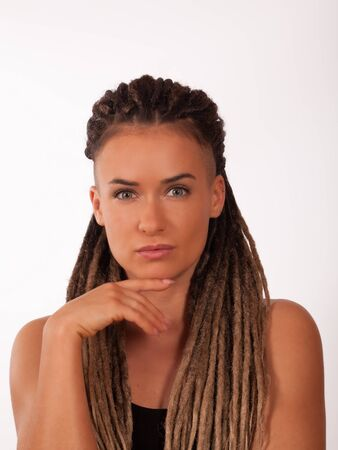 Portrait of a European girl with African braids and shaved temples on a white background 免版税图像