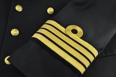 chantier naval: Marine uniforme avec le grade de capitaine sur un manchon