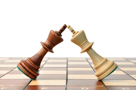 fencing: kings chess duel, kings in battle on the chessboard Stock Photo