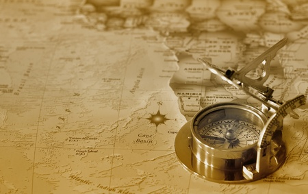 treasure map: An old brass compass on a map background