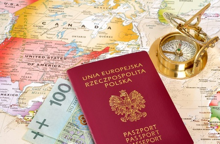 Polish passport and polish money on a map with old compass Stock Photo