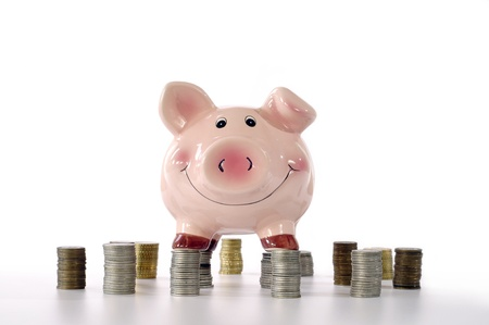 pink piggy banks standing on coins Stock Photo