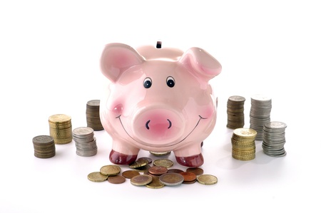 pink piggy banks and coins on a white background Stock Photo
