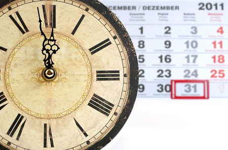 abstract alarm clock: one minute into the New Year, one minute to midnight