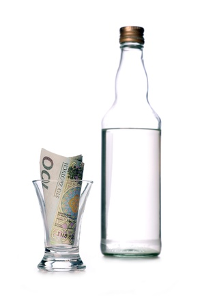 vodka bottle: money lost through alcohol addiction Stock Photo