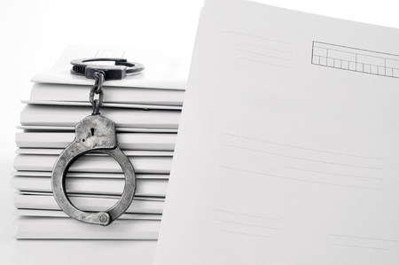 subtitles: handcuffs and case file blank Stock Photo