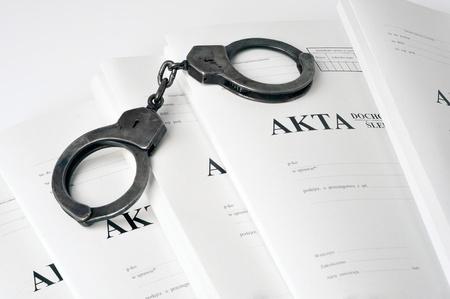 handcuffs and case file (Polish)