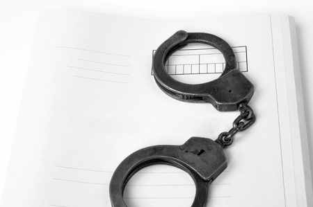 handcuffs and case file (blank) Stock Photo