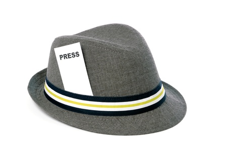 insulate: gray hat with press card isolated Stock Photo