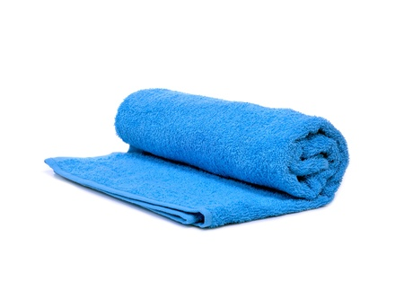 a blue towel rolled up on a white background Stock Photo