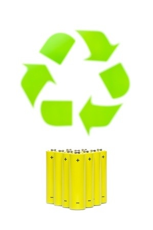 Yellow batteries with recycling symbol on white  photo
