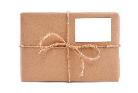 A parcel wrapped in brown paper and tied with rough twine and blank label photo