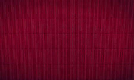 wavy maroon background with vertical stripes
