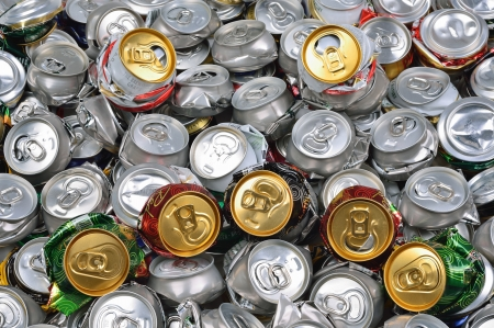Background of crashed beer cans with sad face photo