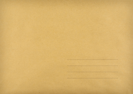 Brown envelope made of striped paper with space for postal address photo